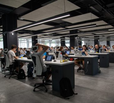 people working at desks in open concept office