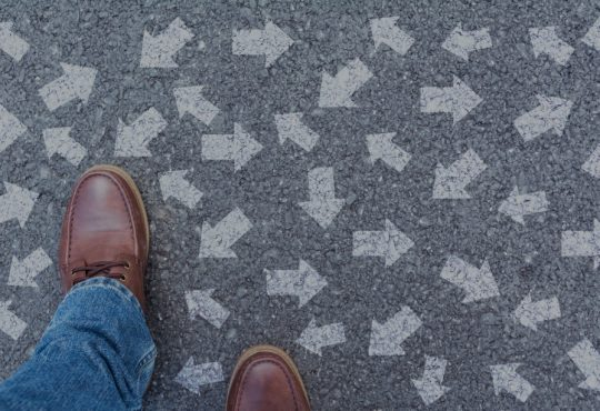 overhead view of shoes with arrows pointing in all directions