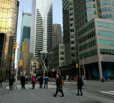 people walking around city's business district