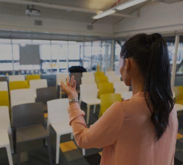 woman practising speech in empty room