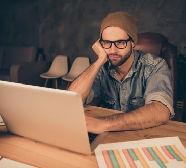 man looking bored working at computer