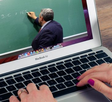 person watching lecture on laptop