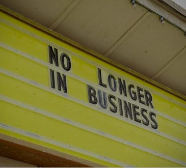 "sign reading ""no longer in business"""