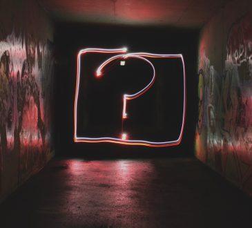 neon question mark on dark background