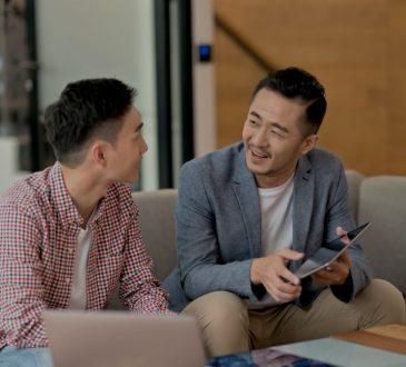 two men talking at work