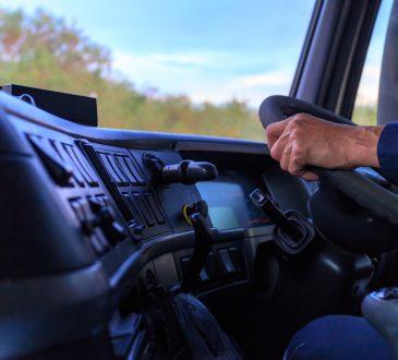 truck driver's hands on wheel