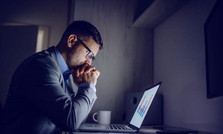 worried man at computer