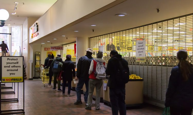 People line up outside grocery store