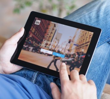 man using linkedin on tablet
