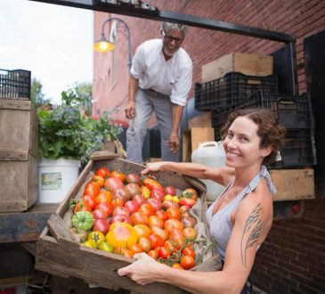 woman loading produce into truck