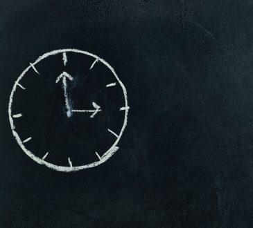clock drawn on chalkboard