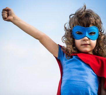 child dressed as superhero