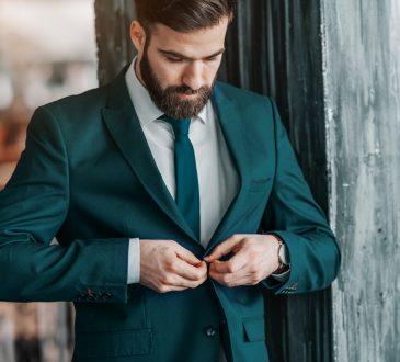 businessman buttoning up suit jacket