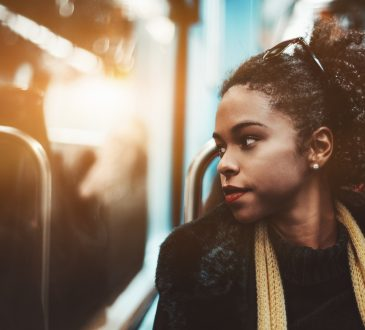 woman lookng out subway window