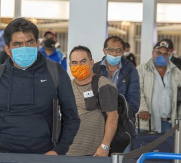 migrant workers lined up at airport customs
