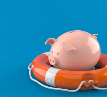 piggy bank inside of floatation device on blue background