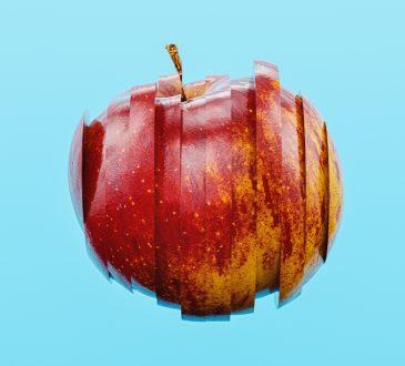 hovering sliced apple