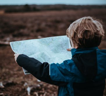 little boy looking at map