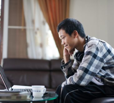 young man watching something on computer
