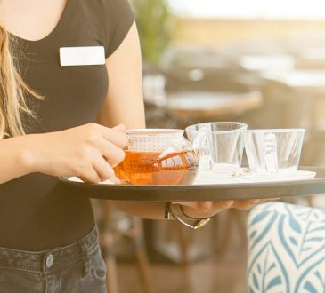 waitress carrying tea