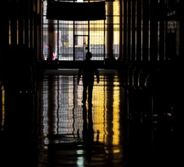 A worker leaves his office building after a day's work in downtown Mexico City on July 3, 2020.