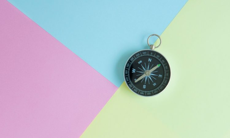 compass on multi-coloured background