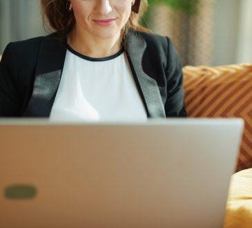 woman wearing blazer using laptop