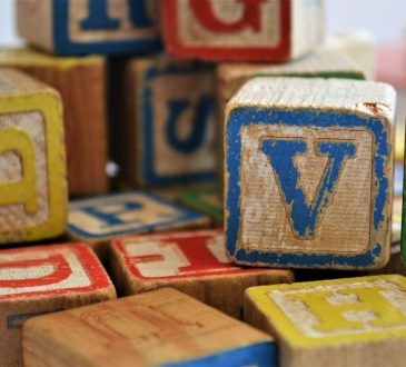 child building blocks with colourful letters