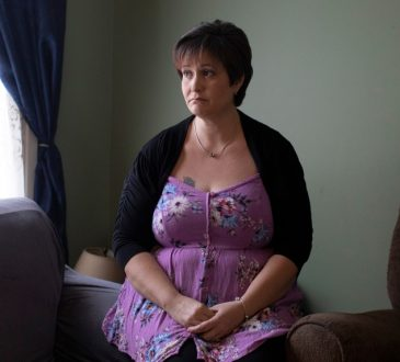 Karyn Keith, who receives CPP disabilities benefits, poses for a portrait in her home in Brampton, Ont.