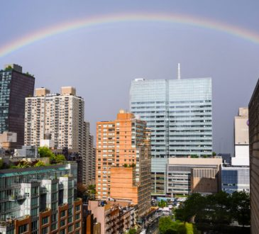 rainbox over cityscape