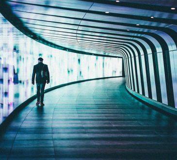 person walking through pedestrian tunnel