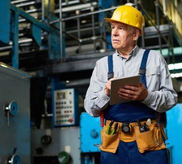 senior factory worker using digital tablet