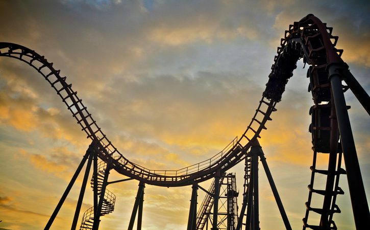 Roller coaster on sunset sky.
