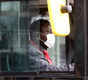 male bus driver seen through window