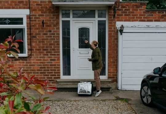 food delivery woman knocking on house door
