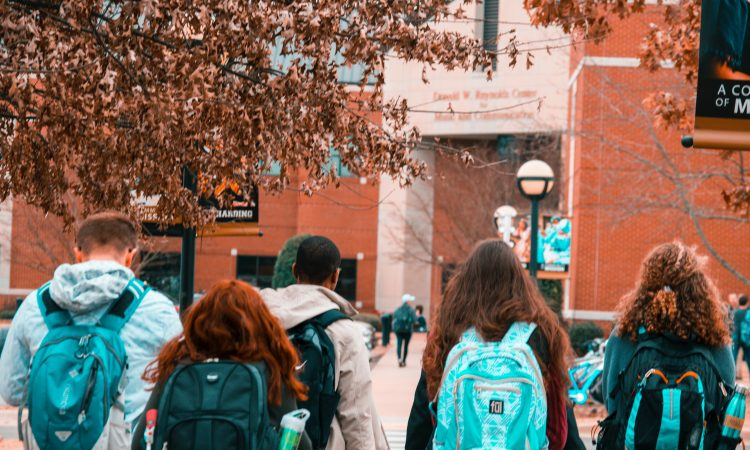 Group of students walking on university campus