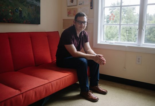 Gabriel Weinberg, DuckDuckGo's founder and chief executive, sitting on red couch.
