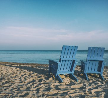 two chairs on sandy beach