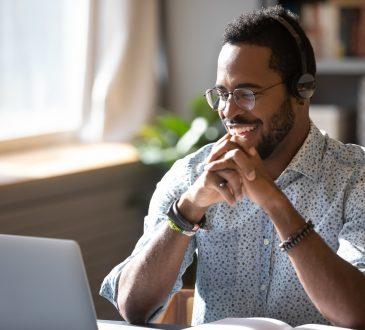 man watching webinar on laptop