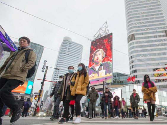 people walking on yonge street in Toronto