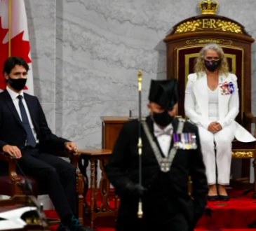 Trudeau sitting in parliament during throne speech