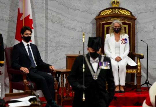Trudeau sitting in parliament during throne speech