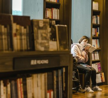 two women studying in library