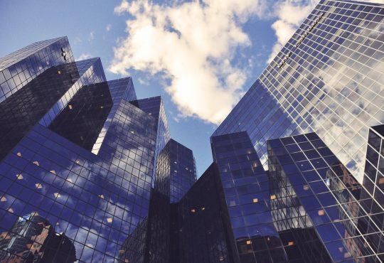 tall glass buildings seen from below