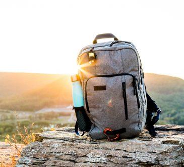 backpack sitting on boulder