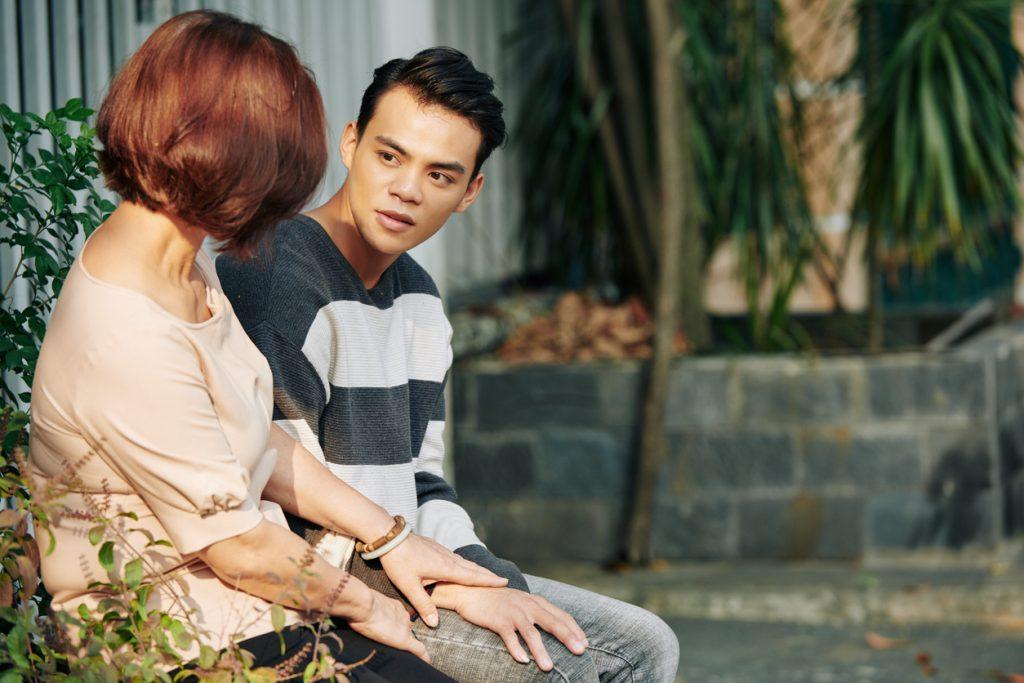 teen boy talking to mom