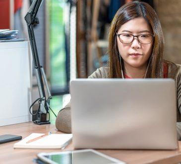 woman watching webinar on laptop