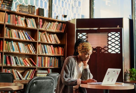 woman using computer in library