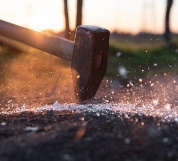 hammer striking metal surface