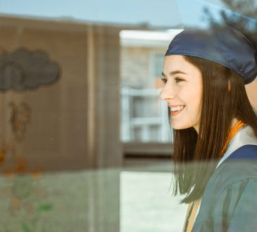woman in graduation cap and gown